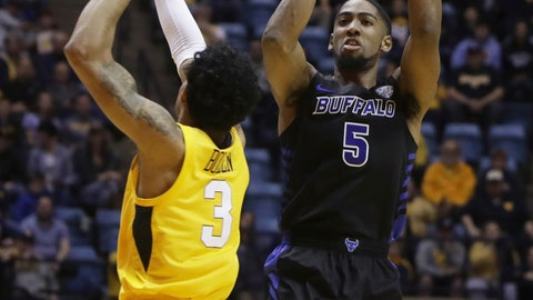 <p>               Buffalo guard CJ Massinburg (5) shoots while defended by West Virginia guard James Bolden (3) during the first half of an NCAA college basketball game, Friday, Nov. 9, 2018, in Morgantown, W.Va. (AP Photo/Raymond Thompson)             </p>