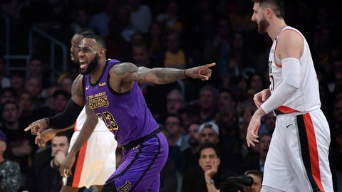 <p>               Los Angeles Lakers forward LeBron James, left, reacts to an inadvertent whistle by a referee as Portland Trail Blazers center Jusuf Nurkic watches during the first half of an NBA basketball game Wednesday, Nov. 14, 2018, in Los Angeles. (AP Photo/Mark J. Terrill)             </p>