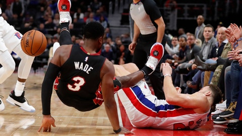 <p>               Miami Heat guard Dwyane Wade (3) falls over Detroit Pistons forward Blake Griffin (23) after they both chased the loose ball during the second half of an NBA basketball game, Monday, Nov. 5, 2018, in Detroit. (AP Photo/Carlos Osorio)             </p>