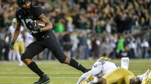 <p>               Oregon wide receiver Dillon Mitchell (13), escapes a tackle in the fourth quarter and runs in for a touchdown against UCLA during an NCAA college football game in Eugene, Ore., Saturday, Nov. 3, 2018 (AP Photo/Thomas Boyd)             </p>