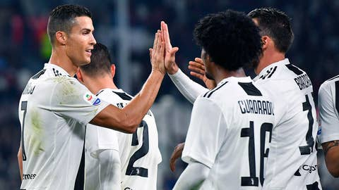 <p>               Juventus' Juan Cuadrado celebrates with his teammate Cristiano Ronaldo, left, after scoring his team's third goal during the Italian Serie A soccer match between Juventus and Cagliari at the Allianz Stadium in Turin, Italy, Saturday, Nov. 3, 2018. (Alessandro Di Marco/ANSA via AP)             </p>