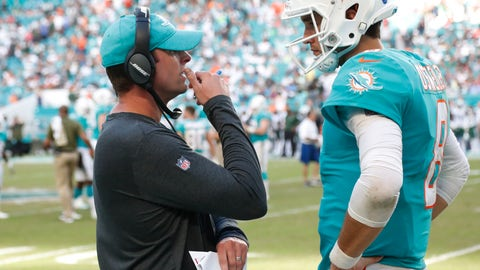 <p>               Miami Dolphins head coach Adam Gase talks to quarterback Brock Osweiler (8), during the second half of an NFL football game against the New York Jets, Sunday, Nov. 4, 2018, in Miami Gardens, Fla. The Dolphins defeated the Jets 13-6. (AP Photo/Wilfredo Lee)             </p>
