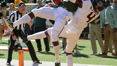 <p>               Baylor's wide receiver Denzel Mims, left, pulls down the game winning touchdown over Oklahoma State's cornerback A.J. Green, right, in the second half of an NCAA college football game, Saturday, Nov. 3, 2018, in Waco, Texas. (Michael Bancale/Waco Tribune-Herald via AP)             </p>