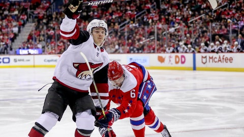 <p>               Arizona Coyotes center Clayton Keller and Washington Capitals defenseman Michal Kempny fight for a lose puck in the third period of an NHL hockey game, Sunday, Nov. 11, 2018 in Washington. The Coyotes won 4-1. (AP Photo/Andrew Harnik)             </p>