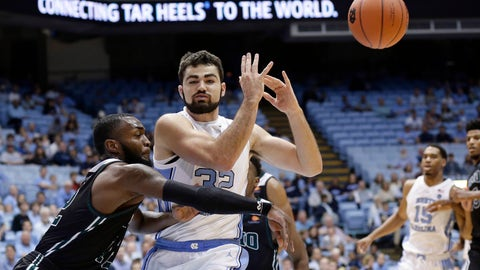 <p>               North Carolina's Luke Maye (32) loses the ball while Mount Olive's Cameron Robinson defends during the first half of a college basketball exhibition game in Chapel Hill, N.C., Friday, Nov. 2, 2018. (AP Photo/Gerry Broome)             </p>