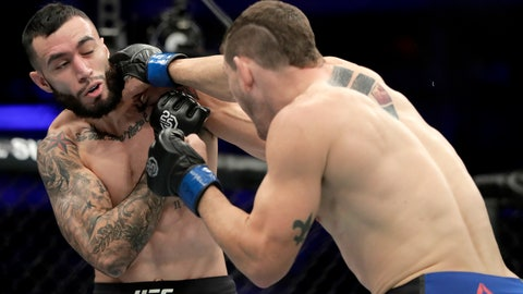 <p>               Kurt Holobaugh, right, lands a punch to Shane Burgos during the first round of a featherweight mixed martial arts bout at UFC 230, Saturday, Nov. 3, 2018, at Madison Square Garden in New York. (AP Photo/Julio Cortez)             </p>