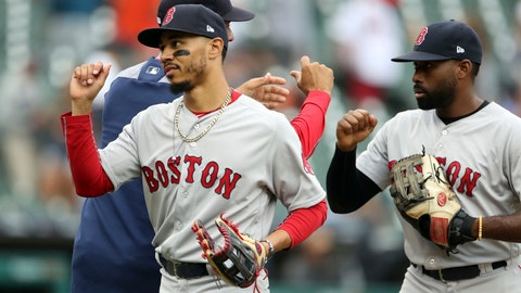 <p>               Boston Red Sox right fielder Mookie Betts, front left, and center fielder Jackie Bradley Jr., right, greet teammates after a win over the Detroit Tigers in a baseball game, Sunday, July 22, 2018, in Detroit. (AP Photo/Carlos Osorio)             </p>
