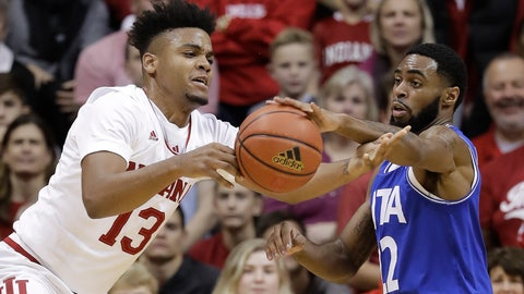 <p>               Indiana's Juwan Morgan and Texas-Arlington's Tiandre Jackson-Young battle for a loose ball during the first half of an NCAA college basketball game, Tuesday, Nov. 20, 2018, in Bloomington, Ind. (AP Photo/Darron Cummings)             </p>