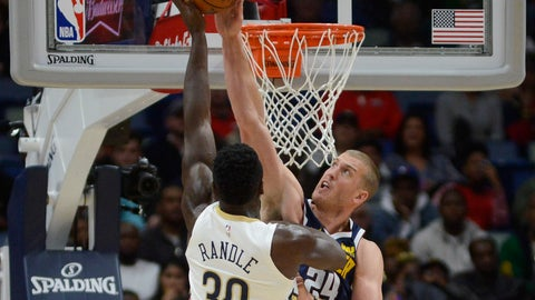 <p>               Denver Nuggets forward Mason Plumlee, right, blocks the ball against New Orleans Pelicans forward Julius Randle (30) during the first half of an NBA basketball game in New Orleans, Saturday, Nov. 17, 2018. (AP Photo/Veronica Dominach)             </p>