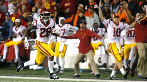 <p>               Southern California' Aca'Cedric Ware (28) races past his bench on a 57-yard touchdown run in the first half of an NCAA college football game against Oregon State in Corvallis, Ore., on Saturday, Nov. 3, 2018. (AP Photo/Timothy J. Gonzalez)             </p>