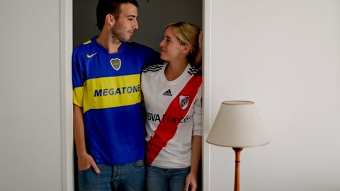 <p>               In this Nov. 7, 2018 photo, Gonzalo Raffo poses for a picture with his wife Delfina Foramitti in Buenos Aires, Argentina. Raffo is a die-hard Boca Juniors fan. His wife passionately roots for River Plate. They watch every game together wearing their team colors. Sometimes they bet: whoever loses must do all the house chores; the winner gets to relax. (AP Photo/Natacha Pisarenko)             </p>