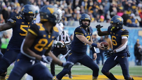 <p>               West Virginia quarterback Will Grier (7) hands the ball off to running back Kennedy McKoy (6) during the first half of an NCAA college football game against TCU, Saturday, Nov. 10, 2018, in Morgantown, W.Va. (AP Photo/Raymond Thompson)             </p>
