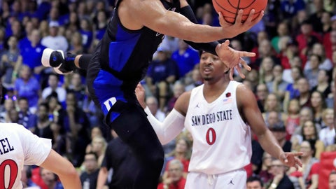 <p>               Duke guard Tre Jones (3) goes up for a basket over San Diego State during the first half of an NCAA college basketball game at the Maui Invitational, Monday, Nov. 19, 2018, in Lahaina, Hawaii. (AP Photo/Marco Garcia)             </p>