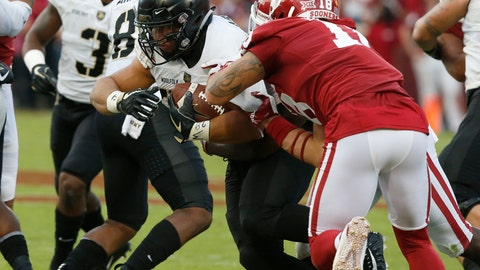 <p>               FILE - In this Sept. 22, 2018, file photo, Army' Darnell Woolfolk (33) carries as Oklahoma linebacker Curtis Bolton (18) defends during an NCAA college football game in Norman, Okla. Army quarterback Kelvin Hopkins Jr. and fullback Woolfolk are leading the team with 671 and 665 yards rushing, respectively. Woolfolk tops the team with nine TDs, one more than his backfield mate, heading into this week's game against Lafayette. (AP Photo/Sue Ogrocki, File)             </p>