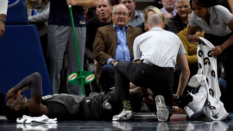 <p>               Brooklyn Nets guard Caris LeVert (22) is tended to after an injury during the second quarter of an NBA basketball game against the Minnesota Timberwolves on Monday, Nov. 12, 2018, in Minneapolis. (AP Photo/Hannah Foslien)             </p>