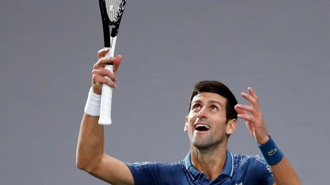 <p>               Serbia's Novak Djokovic celebrates after defeating Bosnia and Herzegovina's Damir Dzumhur during their third round match of the Paris Masters tennis tournament at the Bercy Arena in Paris, France, Thursday, Nov. 1, 2018. (AP Photo/Christophe Ena)             </p>