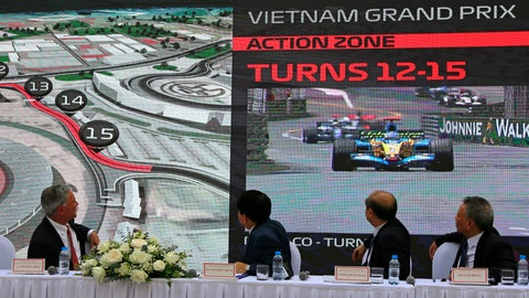 <p>               President and CEO of Formula 1 Chase Carey, left, Hanoi Mayor Nguyen Duc Chung, second from left and two other officials watch the Hanoi F1 circuit design on the screen in Hanoi, Vietnam, Wednesday, Nov. 7, 2018. Formula 1 and Hanoi officials on Wednesday announce that the Vietnamese capital will be added to the calendar of F1 starting from 2020 season. (AP Photo/Tran Van Minh)             </p>