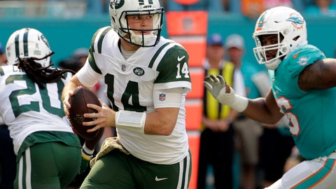 <p>               FILE- In this Sunday, Nov. 4, 2018, file photo, New York Jets quarterback Sam Darnold (14) looks to pass, during the first half of an NFL football game against the Miami Dolphins in Miami Gardens, Fla. Many teams think it's best to throw rookie QBs right into the fire to learn on the job. Others prefer to gradually work them into the offense. Then, there are some who believe it's more beneficial to have them grab a cap and a clipboard and take it all in from the sideline. (AP Photo/Lynne Sladky, File)             </p>