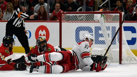 <p>               Carolina Hurricanes right wing Andrei Svechnikov (37) scores a goal on Chicago Blackhawks goaltender Corey Crawford (50) during the first period of an NHL hockey game Thursday, Nov. 8, 2018, in Chicago. (AP Photo/David Banks)             </p>