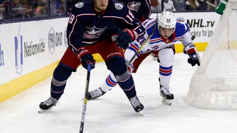 <p>               Columbus Blue Jackets forward Pierre-Luc Dubois, left, chases the puck against New York Rangers forward Jimmy Vesey during the first period of an NHL hockey game in Columbus, Ohio, Saturday, Nov. 10, 2018. (AP Photo/Paul Vernon)             </p>