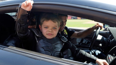 <p>               In this file photo from Tuesday, April 8, 2014, Miles Scott, dressed as Batkid, gestures as he sits in the Batmobile after throwing the ceremonial first pitch before a baseball game between the San Francisco Giants and the Arizona Diamondbacks in San Francisco. On the five-year anniversary of then-5-year-old Miles Scott capturing the hearts of millions by saving the day in San Francisco as Batkid, his Make-A-Wish Foundation dream accomplished at last, the fifth-grader is thriving. (AP Photo/Eric Risberg, Pool)             </p>