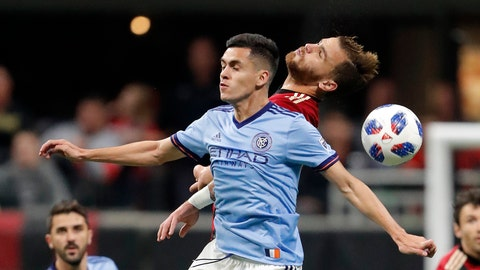 <p>               New York City FC forward Jesus Medina, front center, and Atlanta United defender Leandro Gonzalez, back center, battle for the ball during the first half of an MLS playoff soccer match Sunday, Nov. 11, 2018, in Atlanta. (AP Photo/John Bazemore)             </p>
