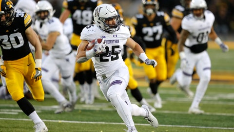 <p>               Northwestern running back Isaiah Bowser runs up field during a 34-yard touchdown run in the second half of an NCAA college football game against Iowa, Saturday, Nov. 10, 2018, in Iowa City, Iowa. Northwestern won 14-10. (AP Photo/Charlie Neibergall)             </p>