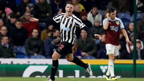 <p>               Newcastle United's Ciaran Clark, left, celebrates scoring against Burnley during the English Premier League soccer match at Turf Moor, Burnley, England, Monday Nov. 26, 2018. (Martin Rickett/PA via AP)             </p>