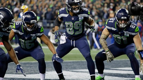 <p>               Seattle Seahawks wide receiver Doug Baldwin (89) takes part in a touchdown celebration with Tyler Lockett, left, and Nick Vannett, right, after Baldwin caught a pass for a touchdown against the Green Bay Packers during the first half of an NFL football game, Thursday, Nov. 15, 2018, in Seattle. (AP Photo/Elaine Thompson)             </p>