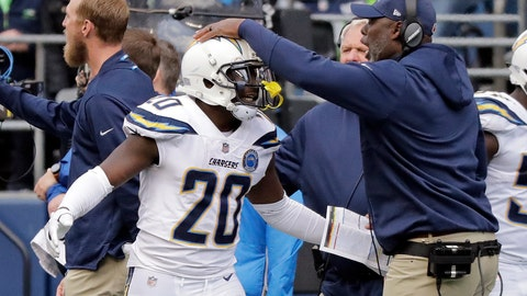 <p>               Los Angeles Chargers' Desmond King (20) is congratulated by head coach Anthony Lynn after his interception and touchdown against the Seattle Seahawks during the second half of an NFL football game, Sunday, Nov. 4, 2018, in Seattle. (AP Photo/Ted S. Warren)             </p>