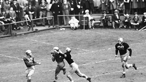 <p>               FILE - In this Nov. 9, 1946, file photo, Notre Dame's Emil Sitko (14) grabs a pass intended for Army's Bill West, center right, during the fourth quarter of a college football game at Yankee Stadium in New York. At left, Notre Dame quarterback John Lujack (32) holds out his hands for a possible lateral. The game ended in a scoreless tie. The Fighting Irish were regular visitors to the New York area during the first half of the 20th Century, when their wanderlust turned Notre Dame football into America's team. (AP Photo/Harry Harris, File)             </p>