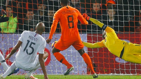 <p>               Netherlands' Georginio Wijnaldum, center, scores his side's first goal passing France's goalkeeper Hugo Lloris, right, during the international friendly soccer match between The Netherlands and France at De Kuip stadium in Rotterdam, Netherlands, Friday, Nov. 16, 2018. (AP Photo/Peter Dejong)             </p>