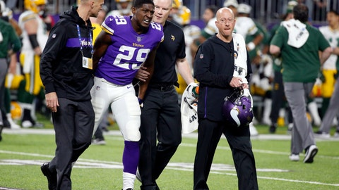 <p>               FILE - In this Sunday, Nov. 25, 2018, file photo, Minnesota Vikings cornerback Xavier Rhodes (29) is helped off the field after getting injured during the second half of an NFL football game against the Green Bay Packers in Minneapolis. Minnesota's secondary has fared well again after some rough spots in the first quarter of the season, but another tough test at New England awaits with the status of Rhodes in question and a challenging matchup with Tom Brady on deck. (AP Photo/Bruce Kluckhohn, File)             </p>