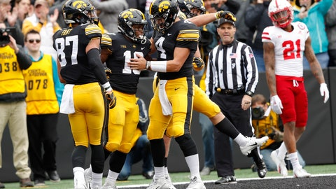 <p>               Iowa running back Mekhi Sargent (10) celebrates with teammates Noah Fant, left, and Nate Stanley (4) after scoring on a 15-yard touchdown run during the first half of an NCAA college football game against Nebraska, Friday, Nov. 23, 2018, in Iowa City, Iowa. (AP Photo/Charlie Neibergall)             </p>