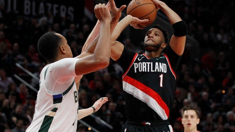 <p>               Portland Trail Blazers guard Evan Turner, right, shoots as Milwaukee Bucks forward John Henson, left, defends during the first half of an NBA basketball game in Portland, Ore., Tuesday, Nov. 6, 2018. (AP Photo/Steve Dipaola)             </p>