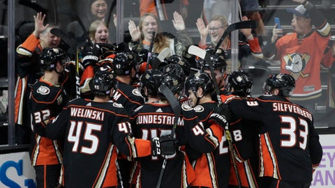 <p>               The Anaheim Ducks players celebrate the team's 3-2 overtime win against the Columbus Blue Jackets in an NHL hockey game against the Columbus Blue Jackets Sunday, Nov. 4, 2018, in Anaheim, Calif. (AP Photo/Jae C. Hong)             </p>