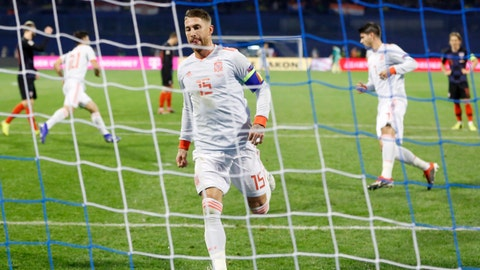 <p>               Spain's Sergio Ramos reacts after scoring his side's second goal from the penalty spot during the UEFA Nations League soccer match between Croatia and Spain at the Maksimir stadium in Zagreb, Croatia, Thursday, Nov. 15, 2018. (AP Photo/Darko Bandic)             </p>