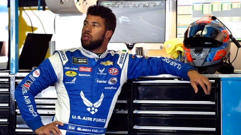 <p>               FILE - In this July 28, 2018, file photo, Bubba Wallace stands in the garage area during practice for a NASCAR Cup Series auto race in Long Pond, Pa. Wallace has two races remaining in a rookie season with a storybook beginning at the Daytona 500. He finished second, the highest ever for a minority in NASCAR's version of the Super Bowl, and it launched Wallace into the national spotlight. (AP Photo/Derik Hamilton, File)             </p>