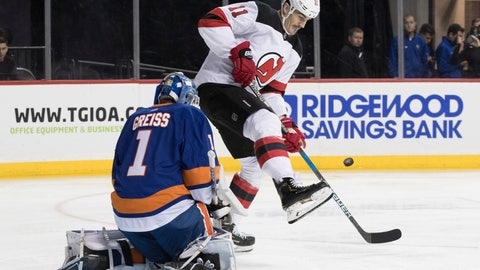 <p>               New York Islanders goaltender Thomas Greiss (1) makes a save against New Jersey Devils center Brian Boyle (11) during the first period of an NHL hockey game, Saturday, Nov. 3, 2018, in New York. (AP Photo/Mary Altaffer)             </p>