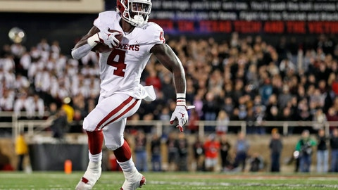 <p>               Oklahoma's Trey Sermon (4) runs downfield with the ball during the first half of an NCAA college football game against Texas Tech, Saturday, Nov. 3, 2018, in Lubbock, Texas. (AP Photo/Brad Tollefson)             </p>