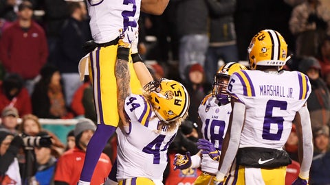 <p>               LSU receiver Justin Jefferson (2) celebrates with teammates Tory Carter (44) Foster Moreau (18) and Terrace Marshall Jr. (6) after scoring a touchdown against Arkansas during the first half of an NCAA college football game, Saturday, Nov. 10, 2018, in Fayetteville, Ark. (AP Photo/Michael Woods)             </p>