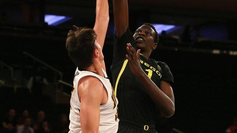Watch Manute Bol's 7'3? son Bol Bol take the court for No. 13 Oregon against Iowa