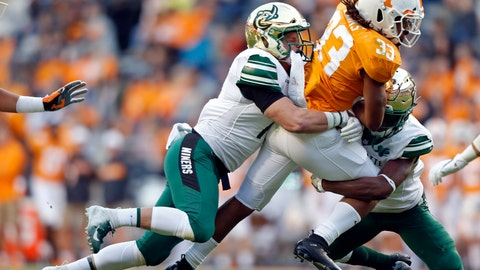 <p>               Tennessee running back Jeremy Banks (33) is tackled by Charlotte linebacker Luke Martin (17) and defensive back Ed Rolle (2) in the second half of an NCAA college football game Saturday, Nov. 3, 2018, in Knoxville, Tenn. Tennessee won 14-3. (AP Photo/Wade Payne)             </p>
