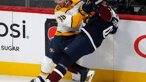 <p>               Nashville Predators right wing Ryan Hartman, left, checks Colorado Avalanche left wing Gabriel Landeskog in the first period of an NHL hockey game Wednesday, Nov. 7, 2018, in Denver. (AP Photo/David Zalubowski)             </p>