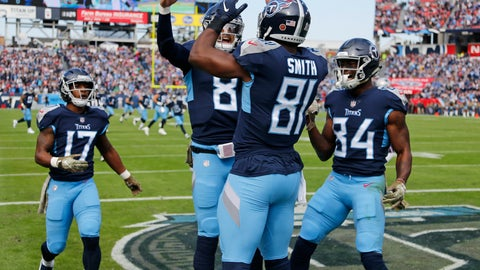 <p>               Tennessee Titans tight end Jonnu Smith (81) celebrates with quarterback Marcus Mariota (8) after Smith caught a touchdown pass against the New England Patriots in the first half of an NFL football game Sunday, Nov. 11, 2018, in Nashville, Tenn. (AP Photo/James Kenney)             </p>