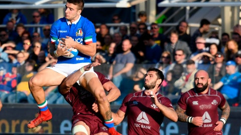 <p>               Italy's Luca Sperandio, left, jumps for the ball during an international test match between Italy and Georgia, at the Artemio Franchi stadium in Florence, Italy, Saturday, Nov. 10, 2018. (Claudio Giovanni/ANSA via AP)             </p>