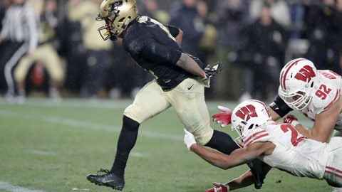<p>               Purdue wide receiver Rondale Moore (4) breaks the tackle of Wisconsin defensive end Matt Henningsen (92) and safety Eric Burrell (25) on his way to a touchdown during overtime of an NCAA college football game in West Lafayette, Ind., Saturday, Nov. 17, 2018. Wisconsin defeated Purdue 47-44 in overtime. (AP Photo/Michael Conroy)             </p>