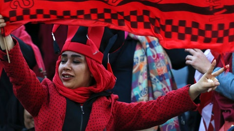 <p>               A female Iranian spectator waves a flag of her favorite team Persepolis prior to start their soccer match with Japan's Kashima Antlers during the 2nd leg of the Asian Champions League finals at the Azadi (freedom) stadium in Tehran, Iran, Saturday, Nov. 10, 2018. Authorities allowed a select group of women into Azadi stadium to watch men's soccer match, a rare move in the Islamic theocracy. Since the 1979 Islamic Revolution women have not been allowed to watch men's soccer matches in stadiums, though they have occasionally been allowed to watch volleyball and basketball in stadiums. (AP Photo/Vahid Salemi)             </p>