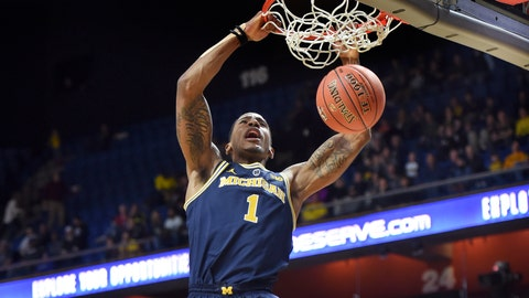 <p>               Michigan's Charles Matthews (1) dunks in the first half of an NCAA college basketball game against George Washington Saturday, Nov. 17, 2018, in Uncasville, Conn. (AP Photo/Stephen Dunn)             </p>