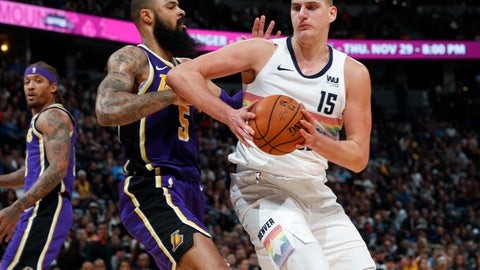 <p>               Denver Nuggets center Nikola Jokic, right, drives the lane to the rim past Los Angeles Lakers center Tyson Chandler during the second half of an NBA basketball game Tuesday, Nov. 27, 2018, in Denver. The Nuggets won 117-85. (AP Photo/David Zalubowski)             </p>